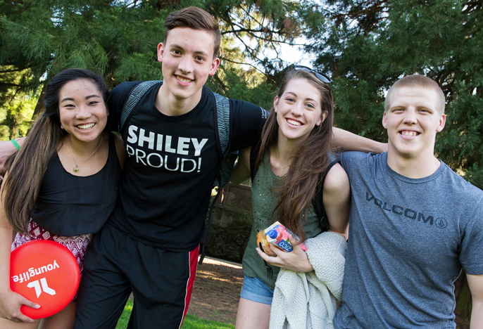 Fours students with a frisbee