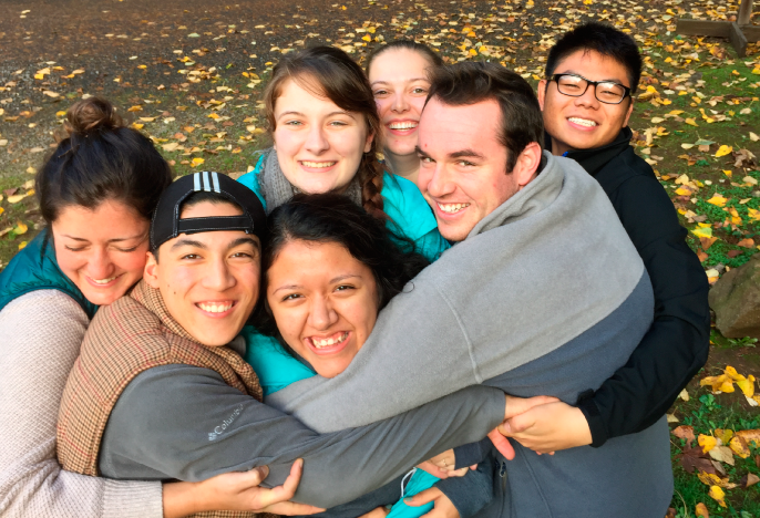 Students in a group hug