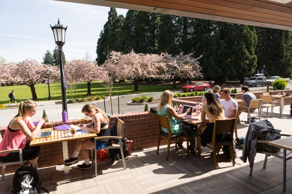 students on pilot house patio