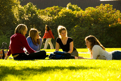 students sitting in grass