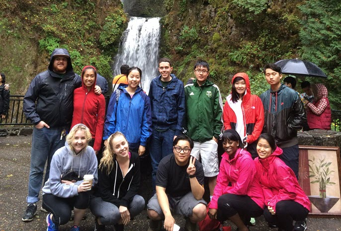 Large group of international students in front of Multnomah Falls
