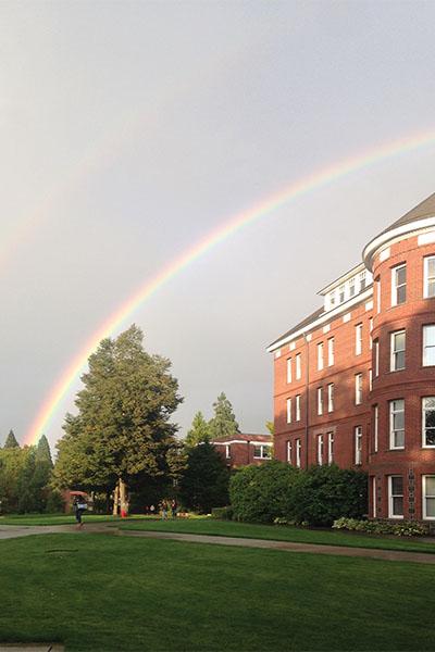 Rainbow rising above Waldschmidt Hall