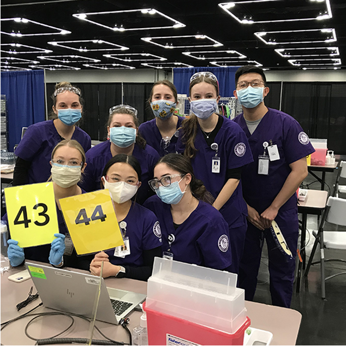Nursing students administering COVID vaccines the Oregon Convention Center