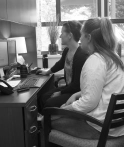 image of student receiving advising, link to information about advising as mentorship