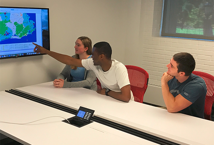 Students working around a conference table